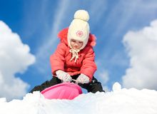 Girl with sleds on the hill Royalty Free Stock Photo
