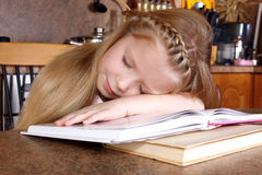 Girl sleep at books Stock Photos