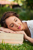 Girl sleep on books Royalty Free Stock Images
