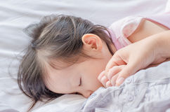 Girl sleep after breast feeding Stock Photo