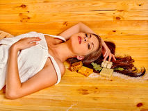 Girl sleep in sauna Stock Images
