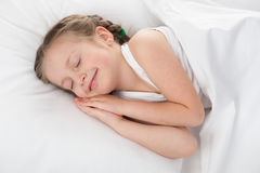 Girl sleep in white bed Royalty Free Stock Images