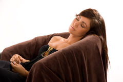 Girl sleeping. Girl wearing a strapless black dress sleeping in chair Stock Image