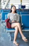 Girl sleeping in airport waiting hall. Girl sleeping in the airport waiting hall royalty free stock photo