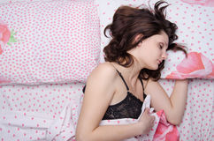 Girl sleeping alone in a double bed Royalty Free Stock Images