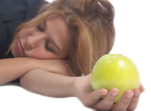 Girl sleeping with apple Royalty Free Stock Image