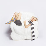 Girl sleeping in arm-chair Royalty Free Stock Image