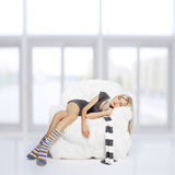Girl sleeping in arm-chair Stock Image