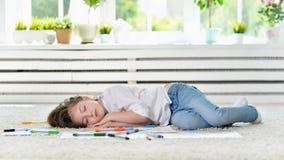Girl sleeping during art class. Cute student girl sleeping during art class royalty free stock photo