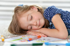 Girl sleeping during art class Stock Images