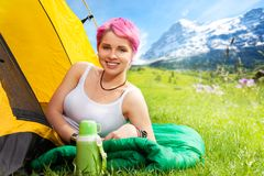 Girl on sleeping bag Royalty Free Stock Photos
