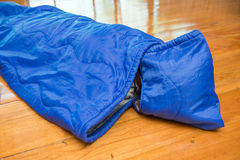 Girl in sleeping bag for camping Stock Photo
