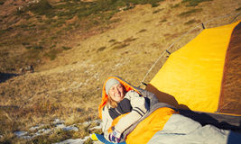 Girl in a sleeping bag. Stock Photo