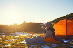 Girl in a sleeping bag. Stock Photos