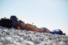 Girl sleeping on the beach Stock Image