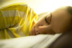 The girl is sleeping. Beautiful girl is sleeping in the bedroom Royalty Free Stock Images