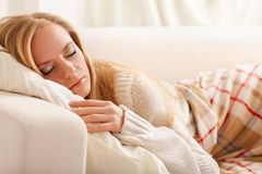 Girl sleeping. Beauty girl sleeping on the sofa Stock Image