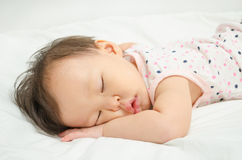 Girl sleeping on bed. Asian baby girl sleeping on bed Royalty Free Stock Image