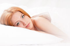 Girl is sleeping on bed Stock Images
