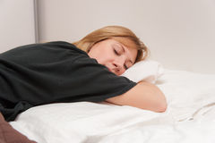 Girl Sleeping in Bed Royalty Free Stock Photography