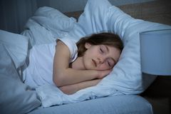 Girl Sleeping On Bed Royalty Free Stock Image