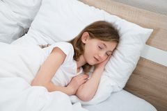 Girl Sleeping In Bed Stock Images