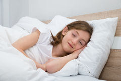 Girl Sleeping In Bed Royalty Free Stock Images