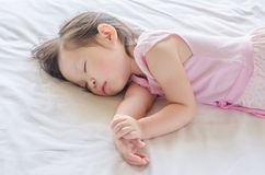 Girl sleeping on bed at day time Royalty Free Stock Image