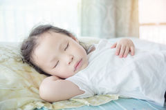 Girl sleeping on bed at day time Royalty Free Stock Photos