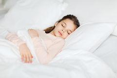 Girl sleeping in bed at home Stock Photo