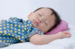 Girl sleeping on bed. Little Asian baby girl sleeping on bed Stock Photography