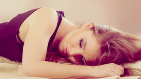 Girl is sleeping on the bed. Royalty Free Stock Images
