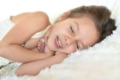 Girl sleeping in bed. Portrait of cute little girl sleeping in bed Stock Photos