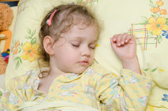 Girl sleeping in bed Royalty Free Stock Image