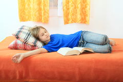 Girl sleeping with a book Stock Photos