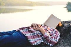 Girl sleeping with book Stock Image