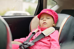 Girl sleeping in car seat Stock Photography