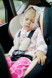 Girl sleeping in car Royalty Free Stock Images