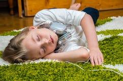 Girl sleeping on the carpet . Stock Photo