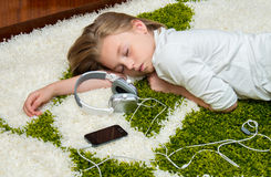 Girl sleeping on the carpet . Stock Photography