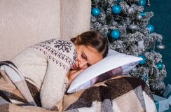 Girl sleeping on Christmas tree background Royalty Free Stock Photos