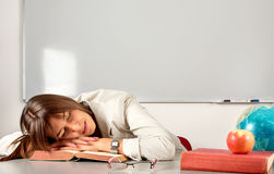 Girl sleeping in classroom Royalty Free Stock Photography