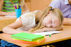 Girl sleeping in classroom Royalty Free Stock Photo