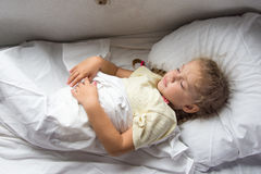 Girl sleeping on a cot in a train Royalty Free Stock Image
