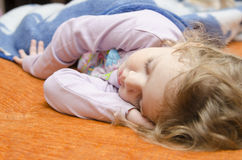 Girl sleeping on the couch Royalty Free Stock Photo