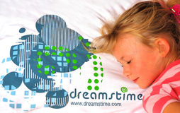 Girl sleeping on Dreamstime pillow Stock Image