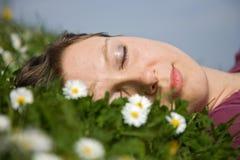 Girl sleeping in the grass stock photos