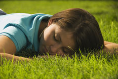 Girl sleeping in grass. During the day Royalty Free Stock Photo