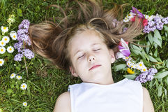 Girl sleeping in the grass Stock Image