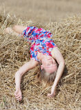 Girl sleeping on a hayloft Stock Images